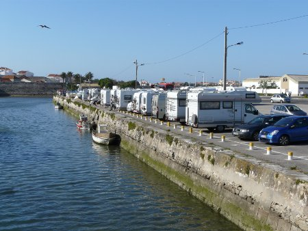 A large, free car park by the harbour in Peniche
