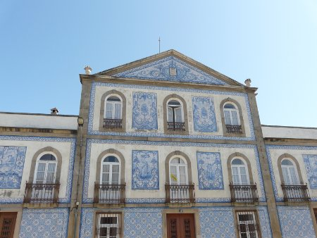 A building decorated with traditional azulejo tiles