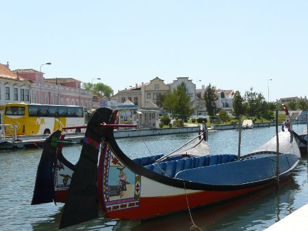 Canalside in Aveiro - needless to say, boat trips and tourists feature prominently, but it's very attractive and well kept
