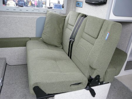 The seat folds our to a good-sized double in about 3 seconds - just flip the base over and drop down the back. It's also a top-quaty RIB road travel seat.