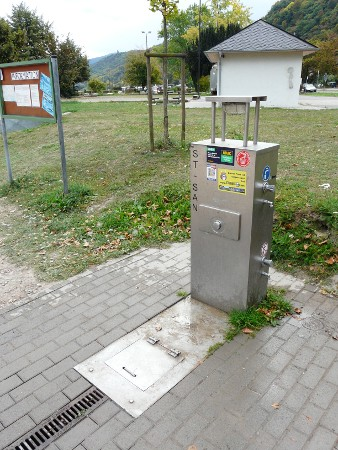A fairly typical German motorhome service point - toilet waste under the metal flap, waste water down the drain and fresh water from the tap at the side (toilet rinsing water from a different tap, lower down)