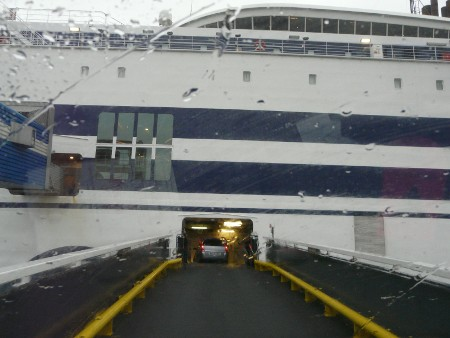 Boarding the ferry in Rotterdam - it's still raining (bigger motorhomes get a wider entrance than this!)