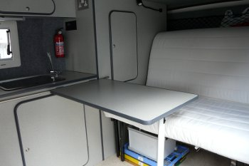 Rock and roll bed in seating position with table