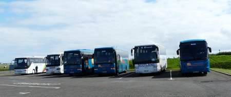 Row of coaches parked at John O'Groats