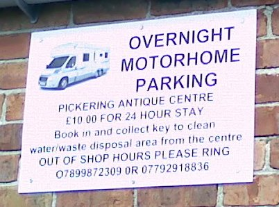 Sign for overnight motorhome parking at Pickering Antique Centre