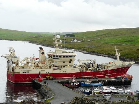 Large fishing boat in small Shetland harbour